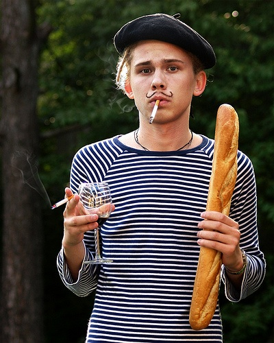 french guy with wine and bread