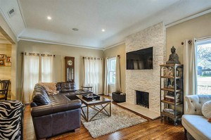 One of two living areas at 5514 Monticello Avenue, this one featuring a beautiful stone fireplace.