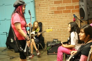 Bass instruction with Rah Stitchez and Kelly Hnot at Girls Rock Dallas.