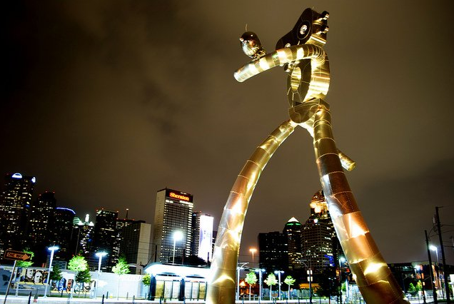 The Traveling Man statue stands by the DART Green Line./ by Flickr user jfernandovaldes