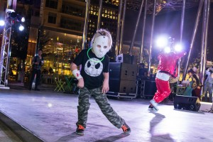 Kid dancing at Decks in the Park Halloween Edition in Klyde Warren Park on October 30th 2014. Photo by: Mason Pelt