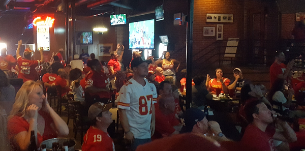 chiefs fans wait on the final ruling about a touchdown