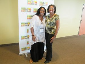Cortina Jackson standing with another author